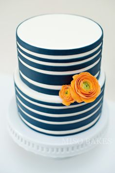 Fresh & Bright Summery Cake.  Navy blue stripes with orange sugarpaste ranunculus by Miso Bakes.
