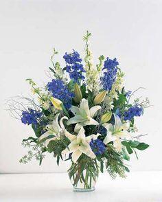 wedding bouquet idea white lilies,white and blue larkspur w/ baby's breath