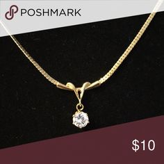 Necklace Gold tone necklace with large very sparkly CZ. Marked 14kGE B.C.Lind. About 17 inches in length Jewelry Necklaces