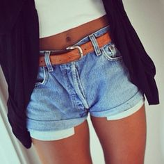 White crop top, leather belt, and shorts.