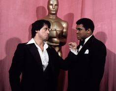 Sylvester Stallone and Muhammad Ali, 1977  Rocky Balboa vs. Muhammad Ali! Sylvester Stallone channels his alter-ego while joking around with the boxing legend during the 1977 Academy Awards.