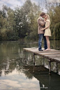 Emma Goulder YOUNG COUPLE KISSING ON JETTY Couples