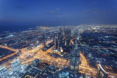 "Dubai Blue Hour - This is a shot taken in Dubai from Burj Khalifa. The Blue hour with the light trails gives a magical feeling. Enjoy!  Visit my: <a href=""https://www.facebook.com/tasoskphotography""> FB Page </a> - <a href=""https://twitter.com/Tasko83""> Twitter  </a> - <a href=""https://plus.google.com/106699010166117105623/posts"">Google+</a> © Copyright Tasos Koutsiaftis. No usage permitted without prior written consent. All rights reserved.  Better view in black"