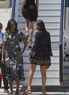 Michelle  and her daughters, pictured boarding their private plane on Friday, had a busy few days in Spain. They were pictured visiting the Prado museum and the First Lady was seen visiting Queen Letizia of Spain
