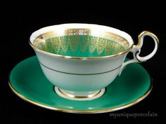 VINTAGE AYNSLEY ENGLAND TEA CUP AND SAUCER GREEN & GOLD LACE ENCRUSTED