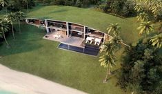 grass roof seamlessly extends outwards into the surroundings