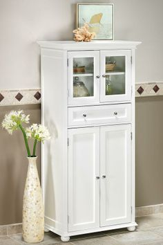 bathroom cabinet http://www.homedecorators.com/P/Hampton_Bay_1-Drawer_Tall_Cabinet/410/ $199