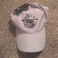 NWT Nike hat NWT Gray Nike Dri-fit hat with exclusive Monday after the Masters Pro am - Hootie & the Blowfish. Size is one size fits all as the back is adjustable. Nike Accessories Hats