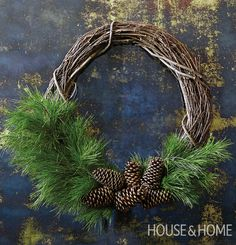 Go beyond evergreen and bows with a rustic offset wreath that's beautifully simple. | Photographer: Kim Jeffery | Designer:Lauren Petroff