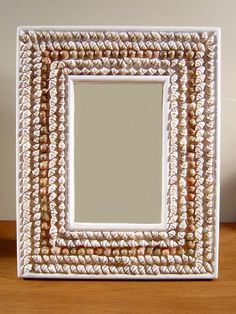 WHITE AND TAN SMALL SHELL FRAMES