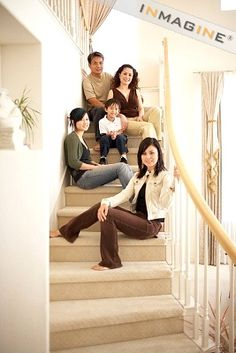 Family posing on stairs photo