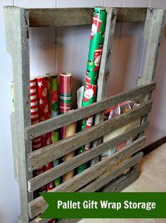 Pallet Gift Wrap Storage.. I could see this in the garage for baseball bats & hockey sticks, too.