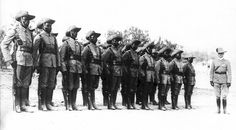 Soldiers of the African Cameroon-Company stand in formation for inspection by a German colonial officer stationed in German Southwest Africa for the purpose of the imperial territory's protection following the subsequent breakout of the Great War. 1914.