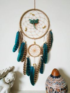 Dreamcatcher Dragonfly dream catcher wall hanging, teal bedroom decor Made with attention and love this dream catcher brings its owners good dreams and positive energy. This beautiful dragonfly dream catcher is the perfect eye-catching piece you need for your home. It also perfect for a baby nursery, bedroom wall decor, bohemian/tribal home decor. Dream Catcher Decor, Feather Dream Catcher, Dream Catcher Boho, Teal Bedroom Decor, Bedroom Wall, Authentic Dream Catchers, Tribal Home Decor, Superhero Gifts, Dream Catcher Native American
