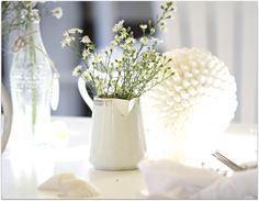 simple white creamer with flowers