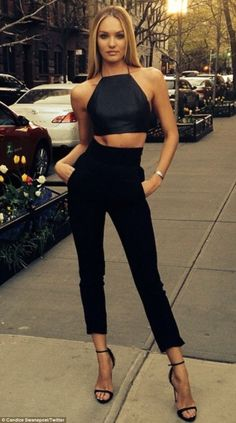 Willowy: The statuesque Victoria's Secret star added to her height with some strappy sanda...