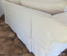Sofa slipcover made with #12 cotton duck cloth from Big Duck Canvas. I added 2 zipper openings at back  -- super easy to get on and off with arthritic hands.