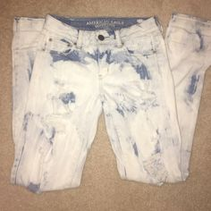 American Eagle Acid-wash Jeans Size 0 American eagle straight stretch acid-wash jeans. Worn once or twice. Minimal distress tears on the front (from production). American Eagle Outfitters Jeans Straight Leg