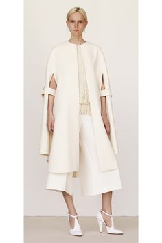 Céline - Resort 2015 - The application of the arm straps on the cape like coat is really innovative and inspiring to my personal practice in terms of aesthetic and functionality- this idea of beautiful practicality
