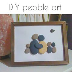 DIY pebble art |  Turn smooth stones into beautiful pictures with this easy pebble art tutorial.  #diy #pebbleart #dollartree