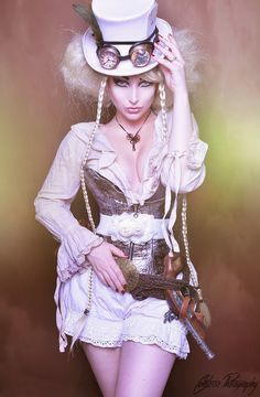 Ivory Steamer - woman in white steampunk costume with top hat, goggles, blouse, corset, belt, gun and shorts.