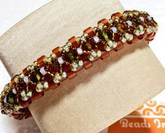 Orblet Banglet $65.00. Peyote stitched Miyuki Delica beads as the base of the bracelet, embellished with Swarovski bicone crystals and seed beads. Based on the original design by Kelly Dale, Off The Beaded Path. #beadsintoart