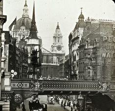Ludgate Hill, across from Fleet Street, in the background is St Paul's. The bridge has been demolished.