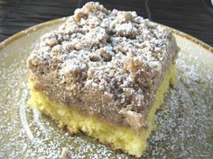 STARBUCKS COFFEE CAKE,!!  1 Box Yellow Cake Mix (plus ingredients on back of box)2 Sticks cold salted butter  2 1/4 Cups flour  1 1/2 Tablespoons cinnamon  1 ¾ Cups brown sugar  1 1/2 Tablespoons vanilla  Powdered sugar (for dusting)