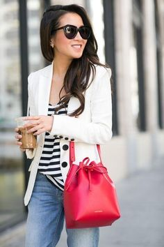 We love how Wendy's Lookbook channeled a nautical vibe by pairing a red bucket bag with a striped tee and an ivory blazer. #Style #Handbag