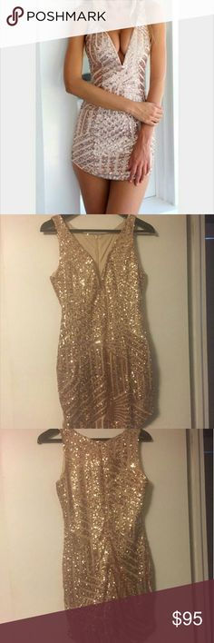 Rose gold dress.  Gourgous for the holidays. Rose gold dress. Never worn.  Great for holidays. Dresses Mini