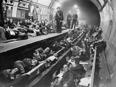 Aldwych tube station, East London. 1940.   The government initially tried to prevent Tube stations being used as air raid shelters. However, Londoners persisted and 79 stations were used as shelters. Aldwych station was closed and converted into a permanent shelter.