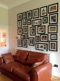 Family photograph gallery wall by Emerald Interior Design