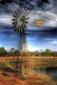 Windmill - in South Australia, this is a very iconic site everywhere in our grand country. Farm Windmill, Windmill Art, Old Windmills, Country Scenes, Water Tower, Old Barns, Le Moulin, Farm Life, Country Life