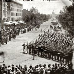 """May 24, 1865. """"Washington, District of Columbia. The Grand Review of the Army. Units of XX Army Corps, Army of Georgia, passing on Pennsylvania Avenue near the Treasury."""" Wet plate negative by Mathew Brady."""