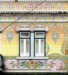 Tile capital of the world, #Lisbon. Festooned with Rococo like colors this little  window is only part of an amazing building that can only be seen in lovely #Lisbon.