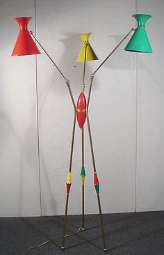 "Rastafarian colors, arachnid-like appendages, and a $10,500 price tag all come with this Arteluce ""Spider"" Floor Lamp."