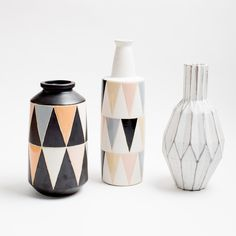 """Add a pop of geometric pattern to your space with the Tribeca Bud Vase. The alternating triangle pattern, and soft color palette is the perfect modern addition to any room. H 16.5"""" x D 5"""". Ceramic."""