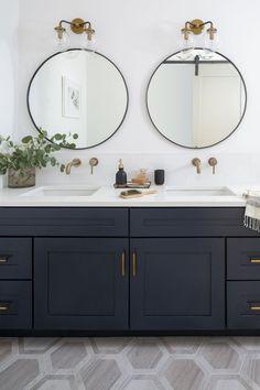 Navy double vanity bathroom with brass fixtures and round mirrors. Navy double vanity bathroom with brass fixtures and round mirrors. Bathroom Vanity Designs, Bathroom Sconces, Bathroom Sink Vanity, Bathroom Interior Design, Bathroom Cabinets, Bathroom Lighting, Vanity Countertop, Bathroom Light Fixtures, Brass Light Fixtures