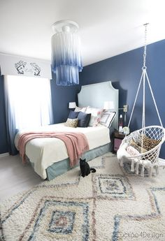 white and blue chandelier in dark blue bedroom indigo dyed fabric chandelier dark blue bedroom colored shag Moroccan shag rug macrame hanging chair ombre curtains leopard pillows - DIY Craft Ideas Dark Blue Bedrooms, Blue Rooms, Girls Bedroom Blue, Blue Walls, Blue Bedroom Colors, Bedroom Brown, Bedroom Turquoise, Bedroom Neutral, Blue Chandelier