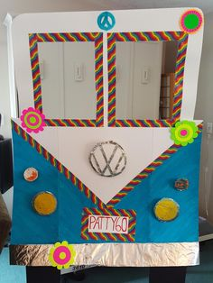 For Sale: Everything you need to throw the perfect 60's/70's themed party!!!! - Volkswagon Bus Photo booth with dress up items, everything from sunglasses, necklaces,beards, pins, head pieces, wig etc. FLOWERS for flower power all over the walls. 16 Extra Large 14 Large 28 Medium  11 small  5 Peace signs and 4 double sided smiley faces roof hangings and flowers and peace signs. 7 disco balls  2 tablecloths with matching napkins, cups and matching napkins Poster Board with Toys and games of…