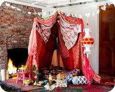 Make a tent with our India blankets. This is a great way to play inside on a rainy day - dreaming of being at a music festival.