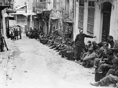 German prisoners of war at Canea, Crete, during World War Shows a row of German paratroopers under New Zealand guard lined up along one side of a street. Photograph taken circa Photographer unidentified. National Library of New Zealand. Luftwaffe, Battle Of Crete, Victory In Europe Day, Invasion Of Poland, Greek History, Prisoners Of War, German Army, Military History, Once Upon A Time