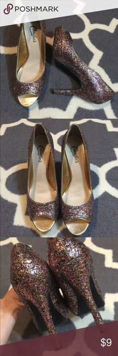Candies glitter heels Super sparkle! These eye catching heels are gently pre owned. Signs of wear minimal. Missing their box. Heel height is 4.5 inches, so not for the faint of heart. Snag a deal! Bundling is fun; check out my other items! No price talk in comments. No trades or holds. NO SPAM. Candie's Shoes Heels
