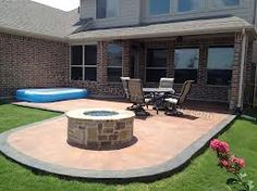 stained concrete patio and fire pit