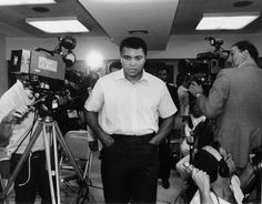 """Former heavyweight boxing champion Muhammad Ali is shown on camera before reporters prior to checking out of a New York hospital, September 21, 1984, following four days of tests. Ali said, """"I'm always tired,"""" after being diagnosed with Parkinson's syndrome. (AP Photo/Mario Cabrera)"""