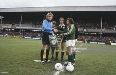 Player manager Johnny Giles of the Republic of Ireland football team exchanges pennants with...