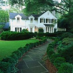I love this house nestle under the trees with a long winding path to the front door. little black door: best of pinterest - curb appeal