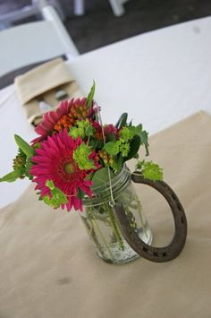 Country Chic Wedding Reception Table Bouquet Centerpiece in pink and green, with a horseshoe!