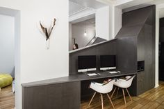 A modern desk area with geometric wood fiber panels