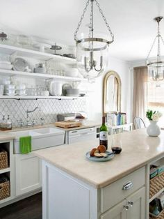 The backsplash is a great place to add a designer touch. In this kitchen by Anisa Darnell, super-trendy arabesque tile, trimmed in gray grout, becomes the focal point.
